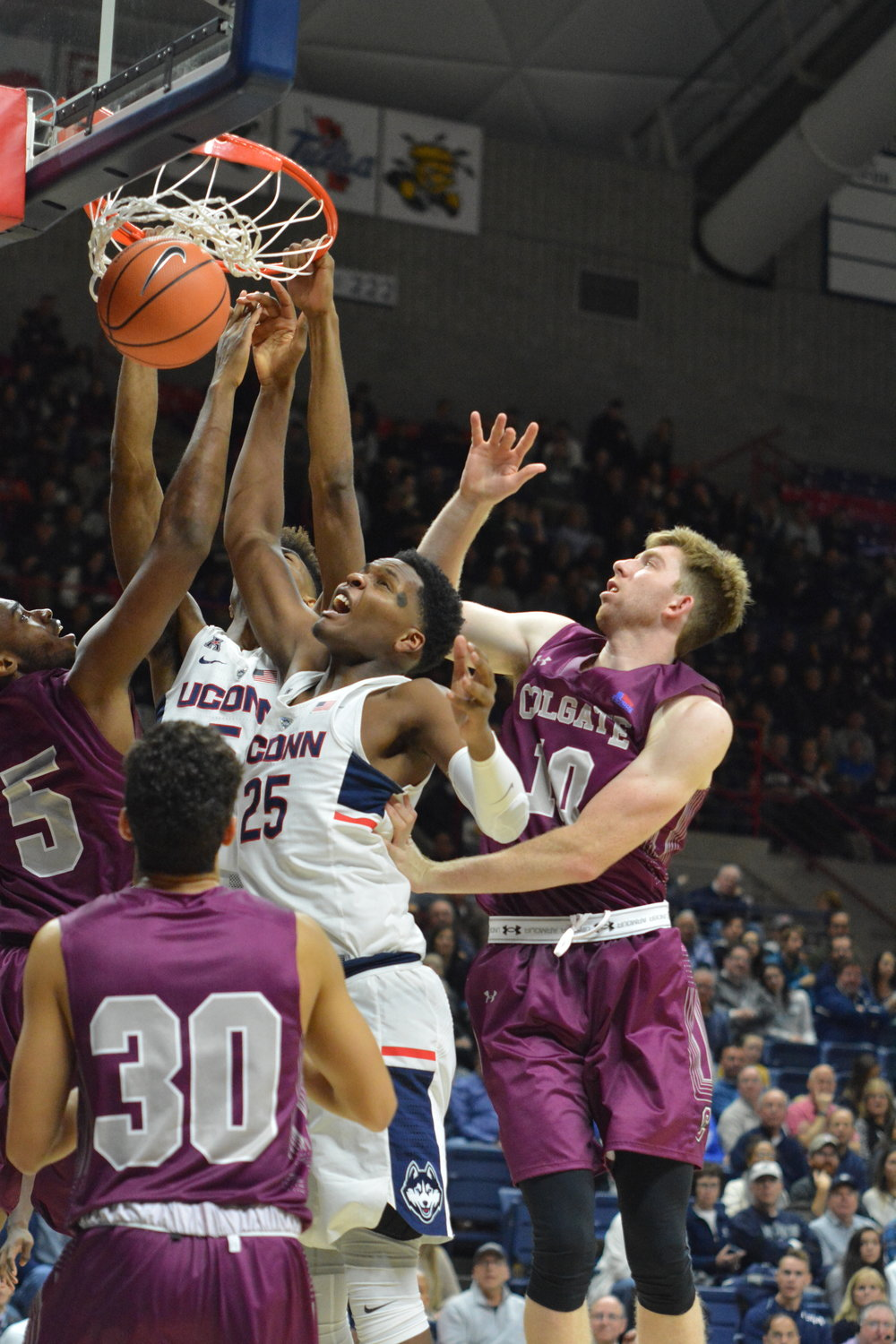 The Men's basketball team opens their home season at Gampel on Friday, November 10 with a game against Colgate. The Huskies won with a final score of 70-58 (Olivia Stenger/The Daily Campus)