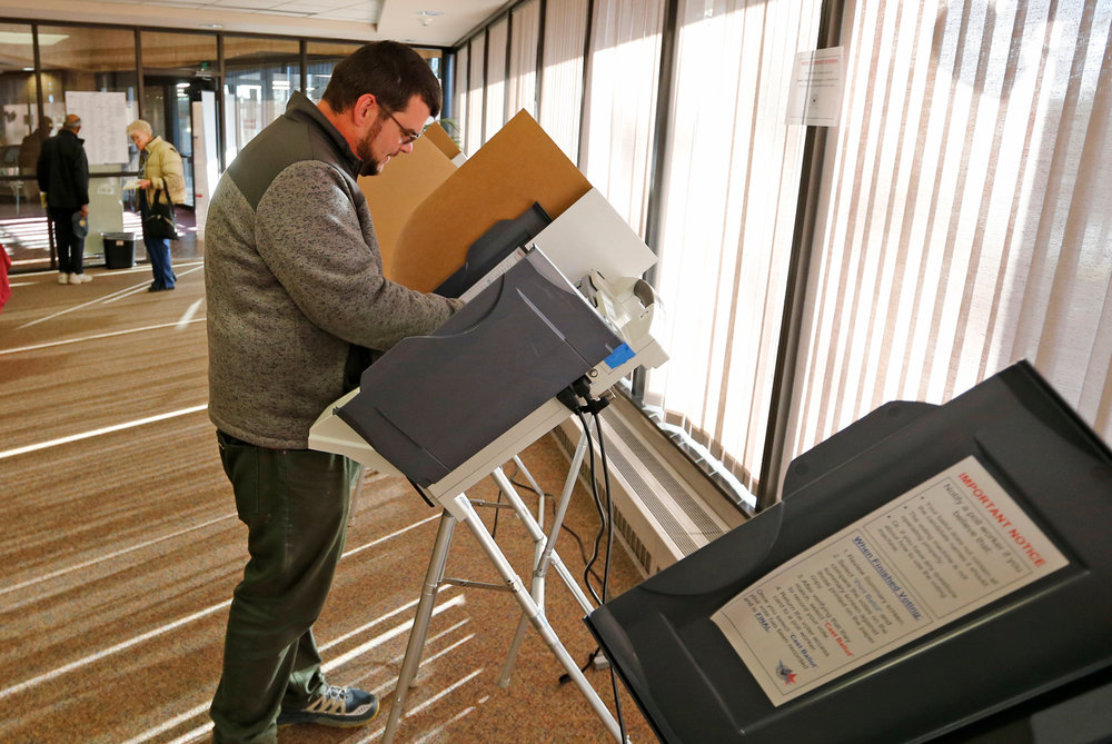 Eric McGill votes at polling place Tuesday, Nov. 7, 2017, in Salt Lake City. The Republican mayor of the Mormon stronghold of Provo is expected to sail to victory in a special election Tuesday to replace former U.S. Rep. Jason Chaffetz in a congressional district where Republicans outnumber Democrats 5-to-1. (AP Photo/Rick Bowmer)