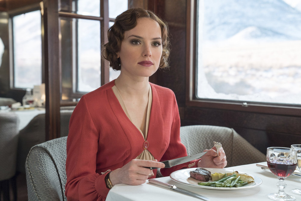 "This image released by Twentieth Century Fox shows Daisy Ridley in a scene from, ""Murder on the Orient Express."" (Nicola Dove/Twentieth Century Fox via AP)"