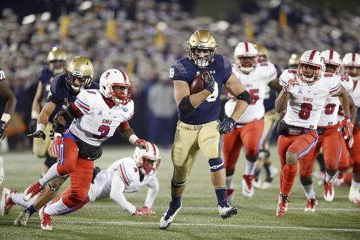 Navy fullback Anthony Gargiulo has a huge run in the fourth quarter of an NCAA college football game against SMU Saturday, Nov. 11, 2017, in Annapolis, MD. (Paul W. Gillespie/The Baltimore Sun via AP)