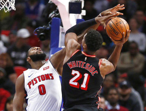 Detroit Pistons center Andre Drummond (0) defends against a shot by Miami Heat center Hassan Whiteside (21) during the second half of an NBA basketball game Sunday, Nov. 12, 2017, in Detroit. The Pistons defeated the Heat 112-103. (AP Photo/Duane Burleson)