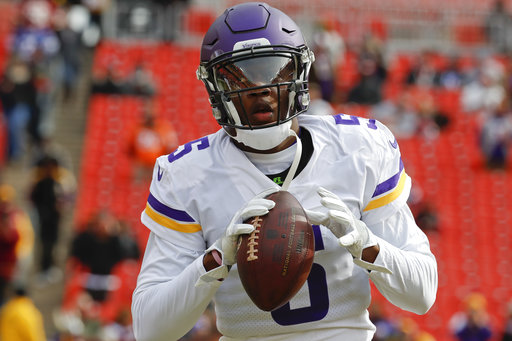 This Nov. 12, 2017 photo shows Minnesota Vikings quarterback Teddy Bridgewater (5) warming up before an NFL football game against the Washington Redskins in Landover, Md. (AP Photo/Alex Brandon)