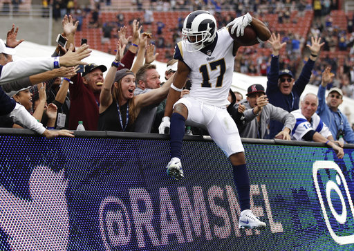 Los Angeles Rams wide receiver Robert Woods celebrates his touchdown against the Houston Texans during the second half of an NFL football game Sunday, Nov. 12, 2017, in Los Angeles. (AP Photo/Jae C. Hong)