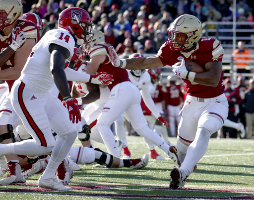 Boston College running back AJ Dillon (2) rushes against the defense of North Carolina State safety Dexter Wright (14) during the first half of an NCAA college football game Saturday, Nov. 11, 2017, in Boston. (AP Photo/Mary Schwalm)