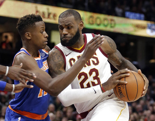 Cleveland Cavaliers' LeBron James, right, drives past New York Knicks' Frank Ntilikina, from France, in the first half of an NBA basketball game, Sunday, Oct. 29, 2017, in Cleveland. (AP Photo/Tony Dejak)