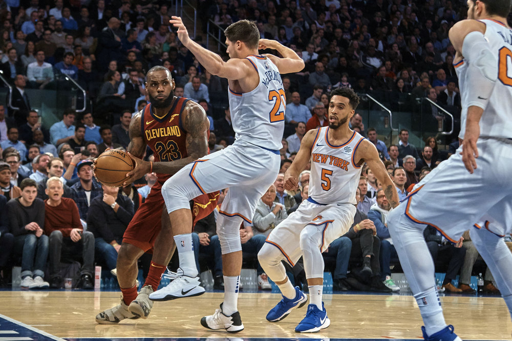 Cleveland Cavaliers' LeBron James, left, dribbles between New York Knicks players during the first half of a NBA basketball game at Madison Square Garden in New York, Monday, Nov. 13, 2017. (Andres Kudacki/AP)