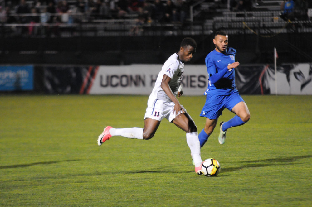Junior captain Abdou Mbacke Thiam (11) led UConn in scoring for the third consecutive season. Thiam scored 10 goals this season, leading the next closest Husky, sophomore Niko Petridis, by seven goals. Thiam also led the team in assists with four. (Jon Sammis/The Daily Campus)