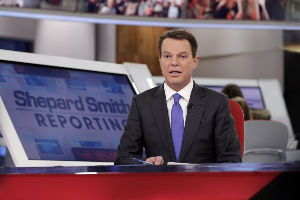 "Fox News Channel chief news anchor Shepard Smith broadcasts from The Fox News Deck during his ""Shepard Smith Reporting"" program, in New York. (AP Photo/Richard Drew, File)"