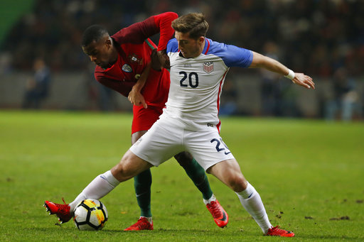 U.S. player Lynden Gooch, right and Portugal's Nelson Semedo challenge for the ball during an international friendly soccer match between Portugal and U.S. at the Dr. Magalhaes Pessoa stadium in Leiria, Portugal, Tuesday Nov. 14, 2017. (AP Photo/Pedro Rocha)