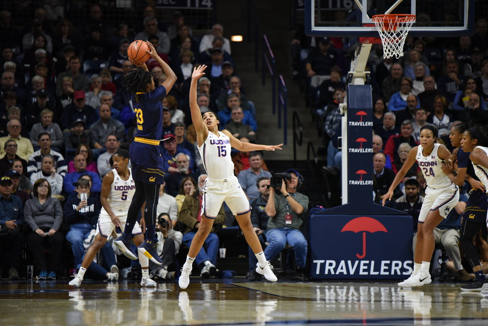 UConn senior forward Gabby Williams contests a shot during the Huskies' 82-47 win over the No. 20 California Golden Bears at Gampel Pavilion on Friday, Nov. 17.   (Photo by Charlotte Lao, Associate Photo Editor/The Daily Campus)