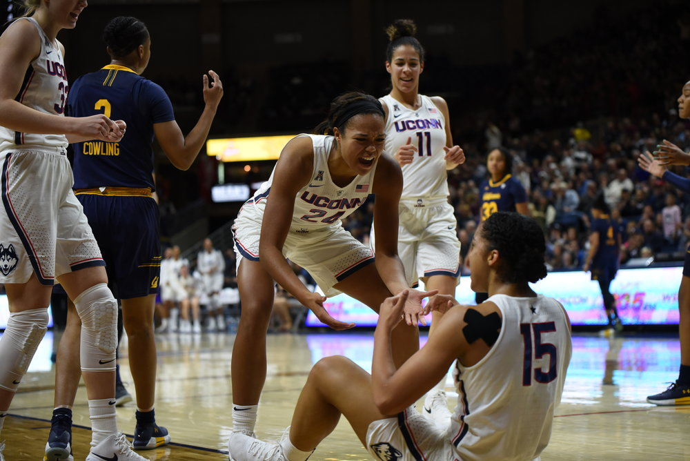 UConn's Katie Lou Samuelson and Kia Nurse run over as Napheesa Collier helps Gabby Williams up after a made layup in the Huskies' 82-47 win over No. 20 California on Friday, Nov. 17 at Gampel Pavilion.    (Photo by Charlotte Lao, Associate Photo Editor/The Daily Campus)