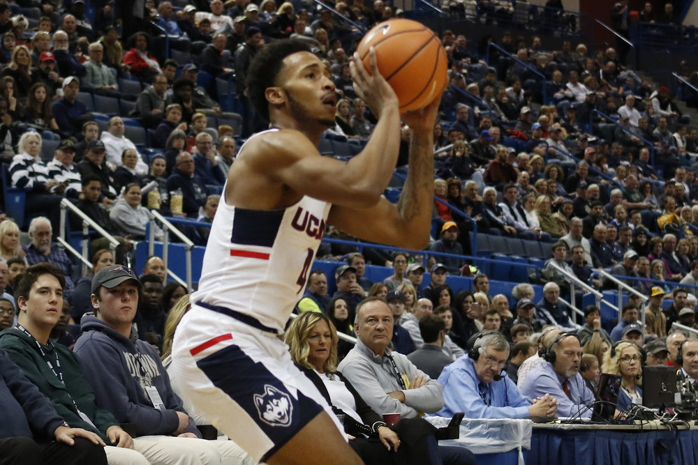 UConn guard Jalen Adams attempts a shot during UConn's 85-66 win over Boston University at the XL Center in Hartford Sunday evening. (Ian Bethune/The UConn Blog)