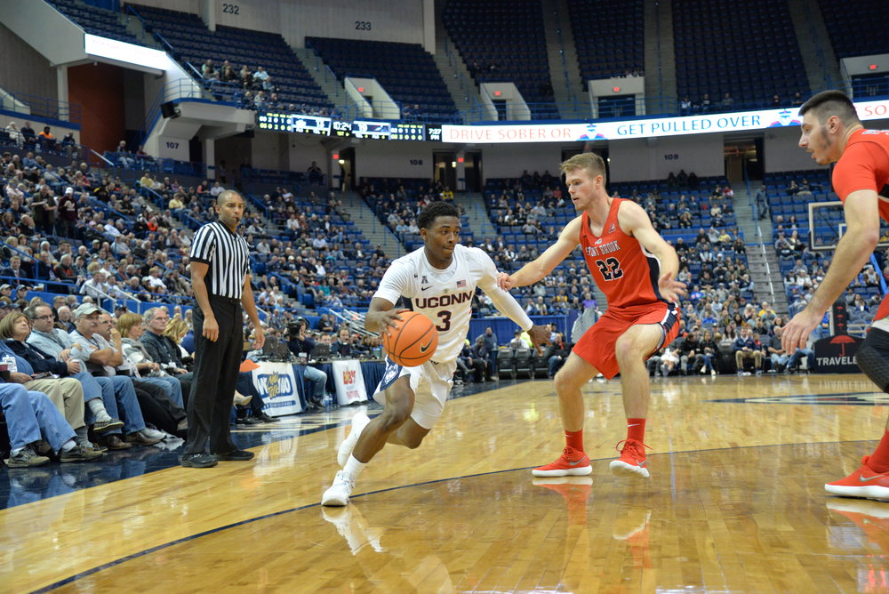 UConn guard Alterique Gilbert tries to drive by a defender during UConn's 72-64 win over Stony Brook on Nov. 14 at the XL Center in Hartford. (Amar Batra/The Daily Campus)