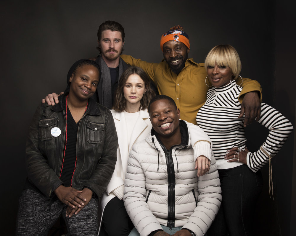 "In this Jan. 21, 2017 file photo, director Dee Rees, clockwise from left, actors Garrett Hedlund, Rob Morgan, Mary J. Blige, Jason Mitchell, Carey Mulligan, middle row center, pose for a portrait to promote the film, ""Mudbound"" during the Sundance Film Festival in Park City, Utah. (Photo by Taylor Jewell/Invision/AP, File)"