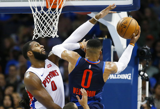 Detroit Pistons center Andre Drummond (0) defends as Oklahoma City Thunder guard Russell Westbrook (0) shoots in the second quarter of an NBA basketball game in Oklahoma City, Friday, Nov. 24, 2017. Detroit won 99-98. (AP Photo/Sue Ogrocki)