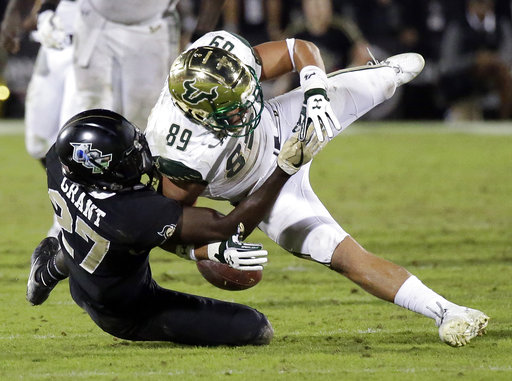 South Florida tight end Mitchell Wilcox (89) fumbles the ball as he is tackled by Central Florida defensive back Richie Grant during the moments of an NCAA college football game, Friday, Nov. 24, 2017, in Orlando, Fla. Central Florida recovered the fumble. (AP Photo/John Raoux)