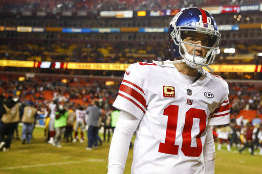 In this Nov. 23, 2017, file photo, New York Giants quarterback Eli Manning (10) walks off the field after a 2010 loss to the Washington Redskins, in an NFL football game in Landover, Md. (AP Photo/Patrick Semansky, File)