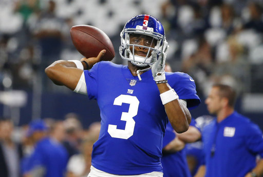 In this Sept. 10, 2017, file photo, New York Giants quarterback Geno Smith (3) throws prior to an NFL football game against the Dallas Cowboys, in Arlington, Texas. (AP Photo/Michael Ainsworth, File)