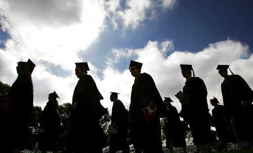 In this Friday, May 12, 2006, file photo, university students in their caps and gowns are silhouetted as they line up for graduation ceremonies in Lawrenceville, N.J. (AP Photo/Mel Evans, File)