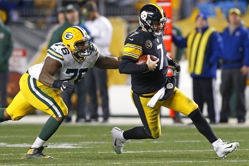 Pittsburgh Steelers quarterback Ben Roethlisberger (7) begins his slide as Green Bay Packers defensive end Mike Daniels (76) attempts to make the tackle on a run during the second half of an NFL football game in Pittsburgh, Sunday, Nov. 26, 2017. (AP Photo/Keith Srakocic)