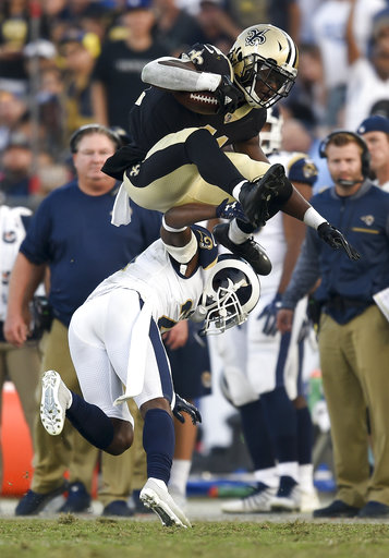 New Orleans Saints running back Alvin Kamara, jumps over Los Angeles Rams cornerback Kayvon Webster during the second half of an NFL football game, Sunday, Nov. 26, 2017, in Los Angeles. (AP Photo/Kelvin Kuo)