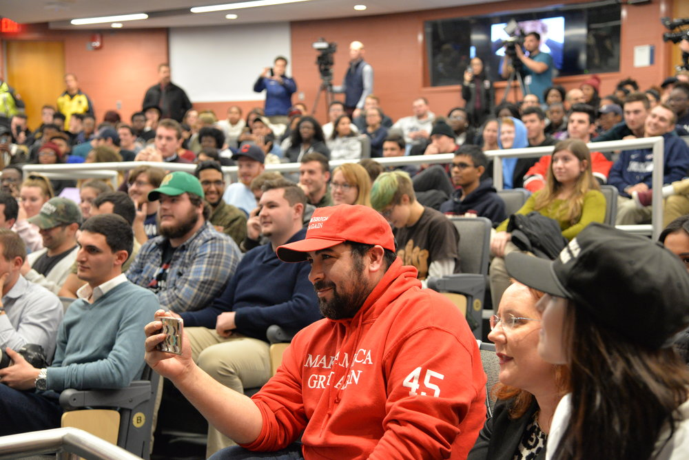 Wintrich was accompanied by his own supporters. Including this man in the red sweatshirt and hat, who was presumably live streaming the event. (Amar Batra/The Daily Campus)