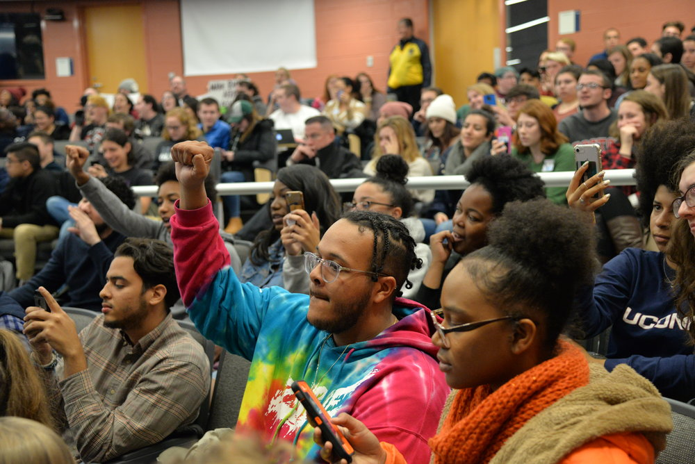 "Another round of ""Black lives matter"" chants erupted as Wintrich began to restart his speech. (Amar Batra/The Daily Campus)"