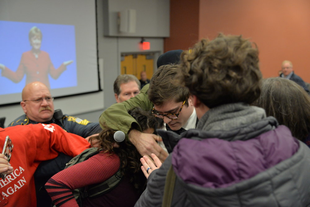 In an instant, an altercation breaks out between Wintrich and a female protestor. (Amar Batra/The Daily Campus)