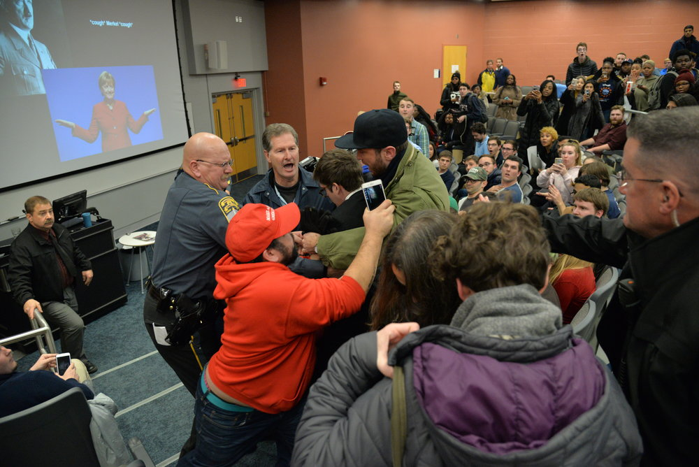 The protestor allegedly took something off of Wintrich's podium. Wintrich chased her up the stairs and grabbed her. Police jumped in immediately. (Amar Batra/The Daily Campus)