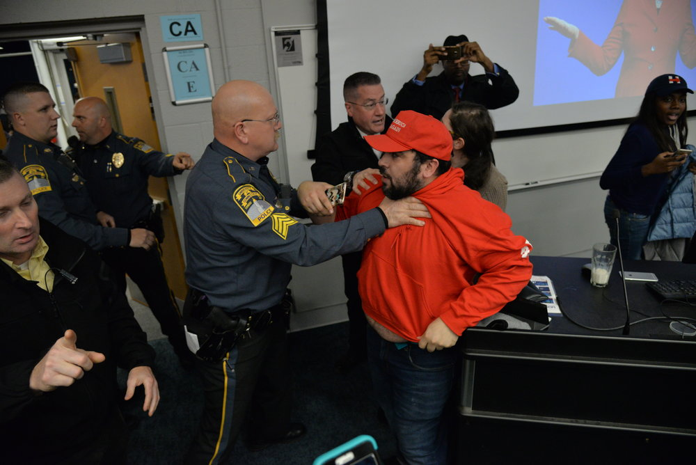 Police restrain the Wintrich supporter from interfering with Wintrich's arrest. (Amar Batra/The Daily Campus)