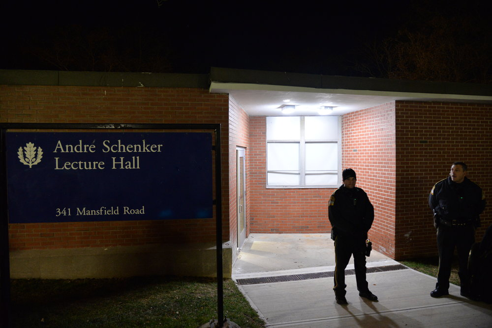 Police guard the backdoor of Schenker Hall after forcing everyone outside the building. (Amar Batra/The Daily Campus)