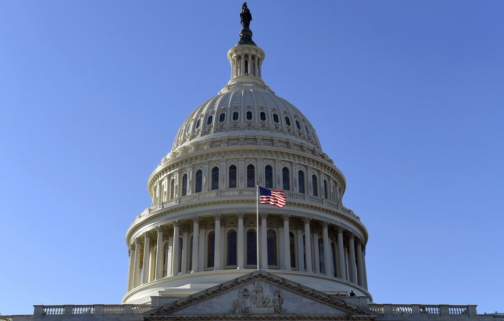 A flag flies on at the U.S. Capitol in Washington, Tuesday, Nov. 28, 2017. (AP Photo/Susan Walsh)