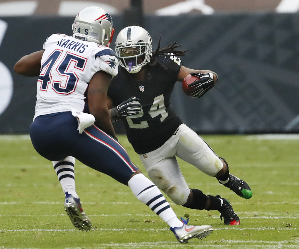 Oakland Raiders running back Marshawn Lynch (24) rushes against New England Patriots linebacker David Harris (45) during the second half of an NFL football game Sunday, Nov. 19, 2017, in Mexico City. (AP Photo/Eduardo Verdugo)