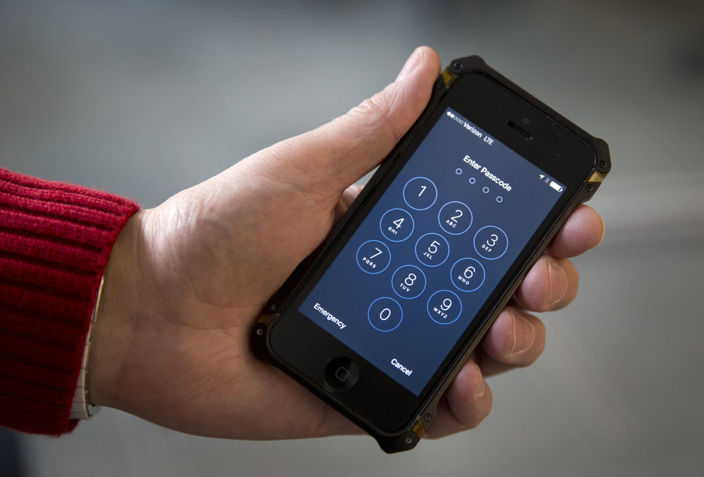 FILE - In this Feb. 17, 2016, file photo an iPhone is seen in Washington. The Supreme Court is hearing a case on Nov. 29, 2017, is taking up a case about privacy rights that could limit the government's ability to track Americans' movements in the digital age. (Carolyn Kaster, File/AP)