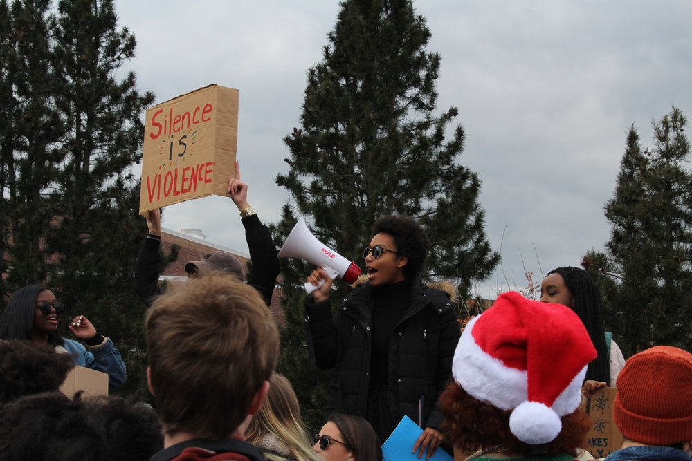 Student organizers teach cheers prior to the start of the March for Action on Friday, Dec. 1, 2017 in front of the Jonathan statue. (Kim Nguyen/The Daily Campus)
