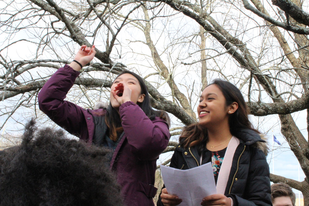 Pan-Asian Council coordinators Aubrey Tang and Shreya Khadka speak about intersectionality between different cultural communities during the March for Action in front of Wilbur Cross on Friday afternoon. (Kim Nguyen/The Daily Campus)