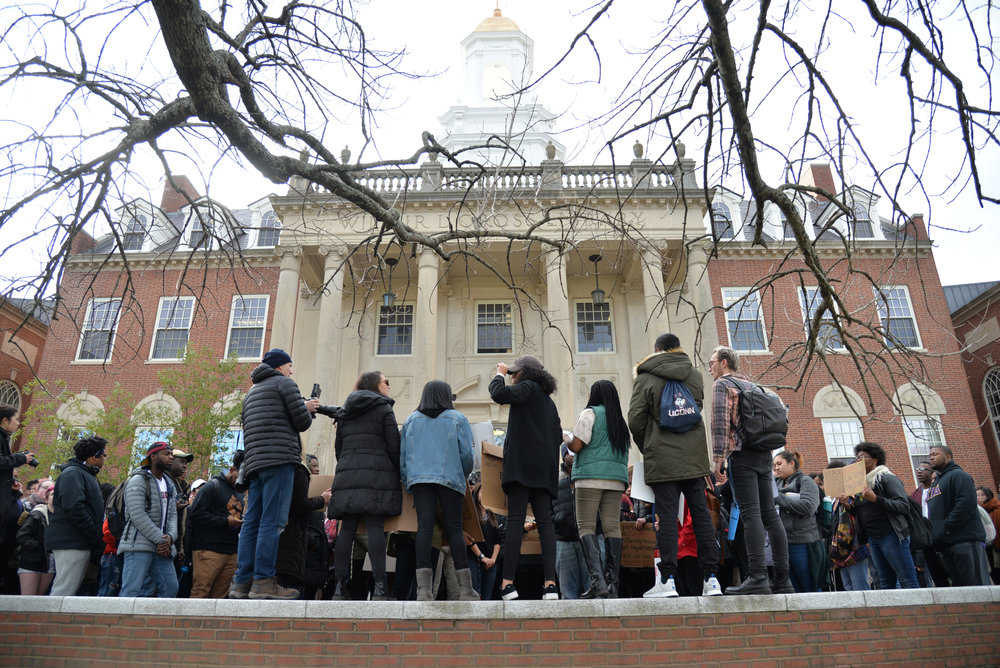 Protestors organize in front of Wilbur Cross and made demands towards the administration on what change they need to see. A formal list of demands will be created and presented with the help of the Undergraduate Student Government. (Amar Batra/The Daily Campus)