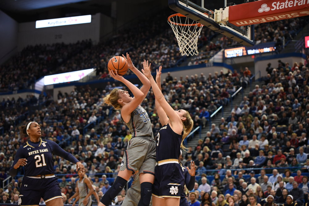 Katie Lou Samuelson (pictured) attacks the basket in Sunday's win against Notre Dame (Charlotte Lao/The Daily Campus)