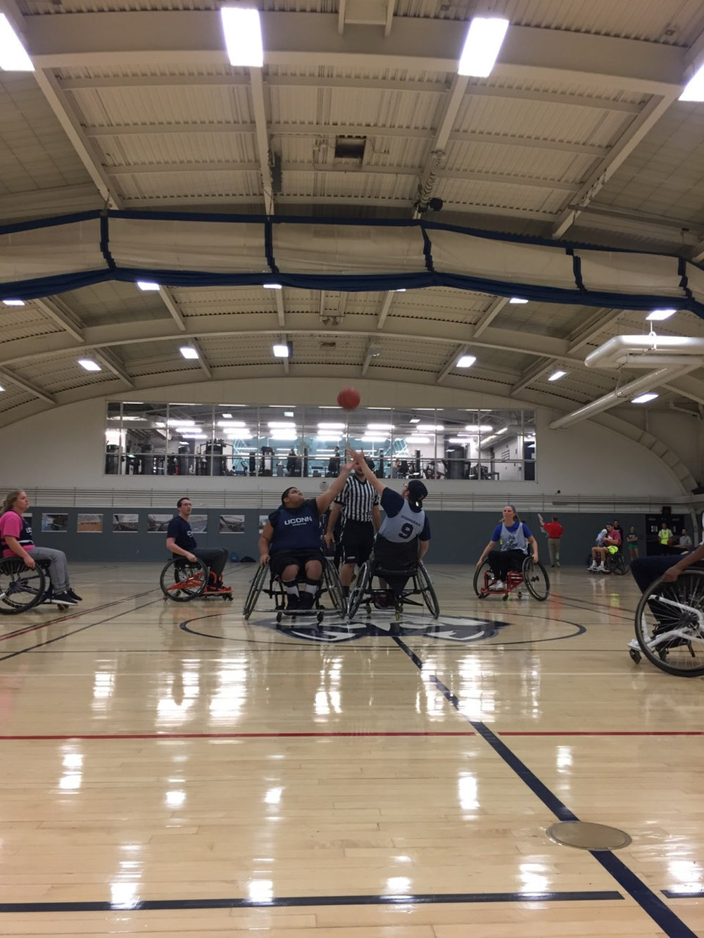 Tip-off in a wheel chair basketball event hosted by UConn Adapted on Thursday night (Kenisha Lee/Husky Adapted)