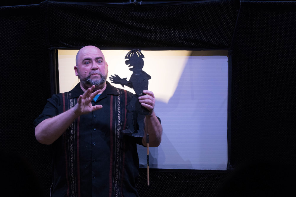 "Jim ""Nappy"" Napolitano uses shadow puppetry to tell the story of how Santa got fired as well as the fun tales with humor for all ages.  (Eric Wang/The Daily Campus)"