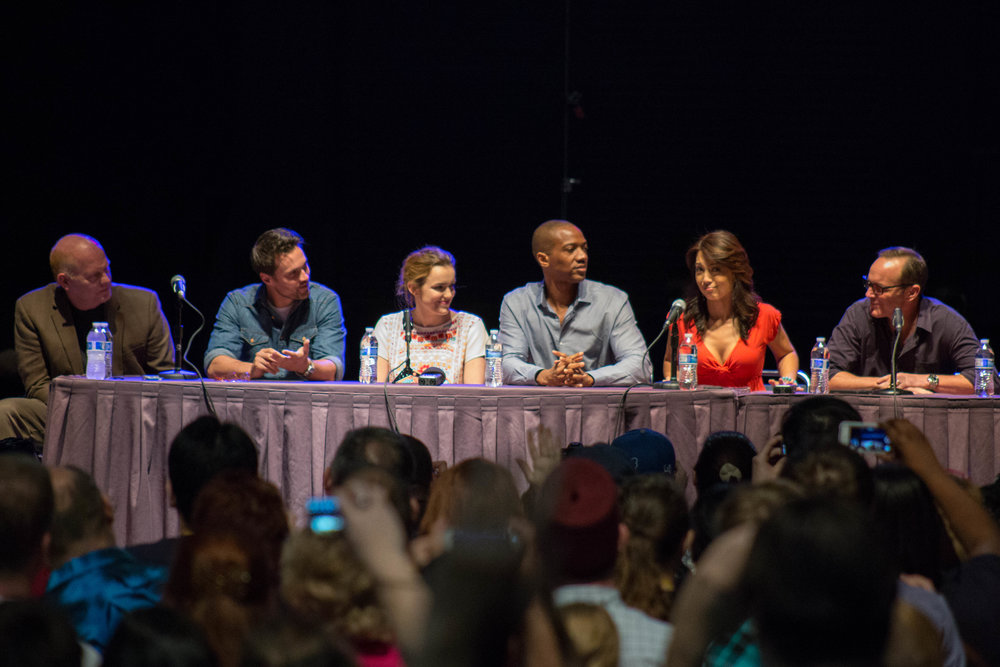 "Agents of S.H.I.E.L.D sit at a panel. The two-hour season five premiere of ""Agents of S.H.I.E.L.D."" has taken the fan-favorite team of Marvel agents to outer space. (Randall Pugh/Flickr Creative Commons)"
