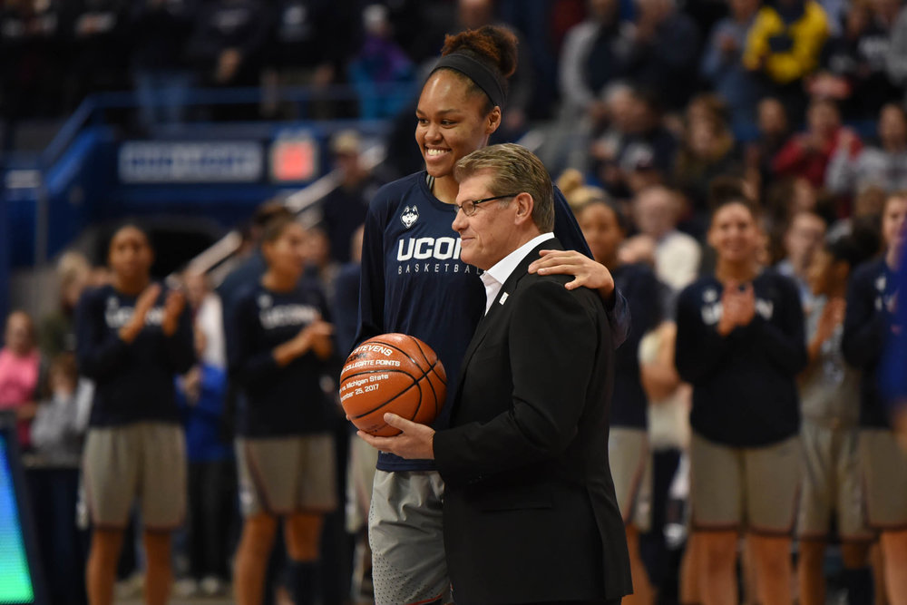 Azura Stevens is awarded for her 1,000 point achievement from playing at Duke and UConn. (Charlotte Lao/The Daily Campus)