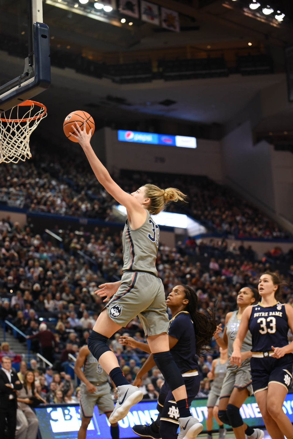 Katie Lou Samuelson goes up for a layup during a fast break. (Charlotte Lao/The Daily Campus)