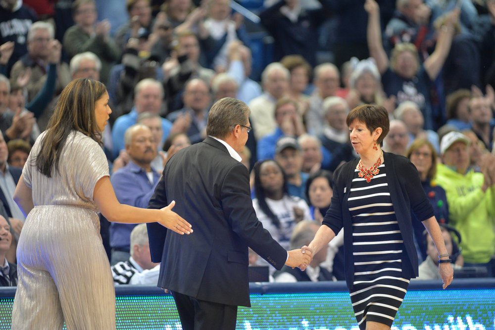Geno Auriemma and Muffet McGraw greet in XL Center before the game starts. The Huskies are the ranked first while Notre Dame is ranked third. (Amar Batra/The Daily Campus)