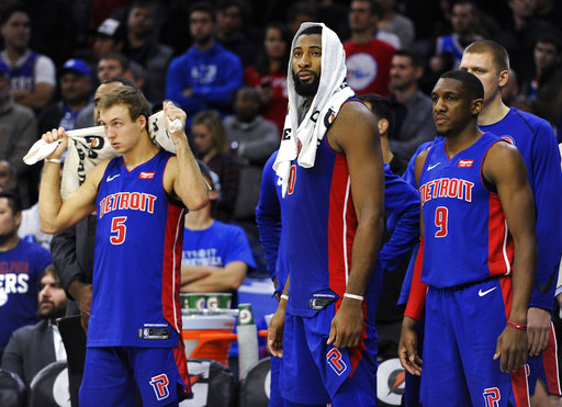 Detroit Pistons' Luke Kennard (5), Andre Drummond (0) and Langston Galloway watch the final minutes of the second half from the bench during an NBA basketball game against the Philadelphia 76ers, Saturday, Dec. 2, 2017, in Philadelphia. (AP Photo/Michael Perez)
