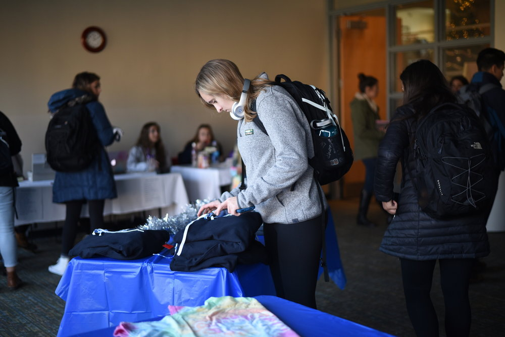 HuskyTHON hosts a pop up shop for past HuskyTHON apparel where the proceeds go towards Connecticut Children's Medical Center. There were a variety of shirts and sweatshirts to choose from. (Charlotte Lao/The Daily Campus)