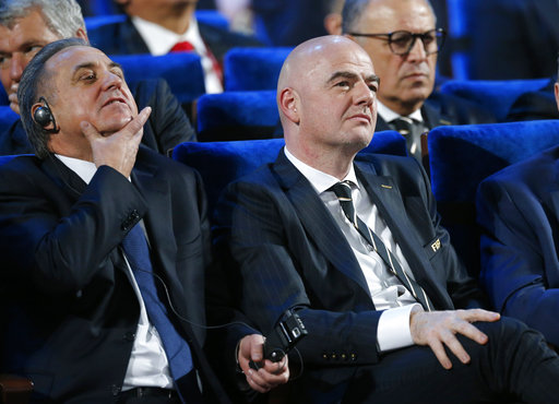 FIFA president Gianni Infantino, right, and Vitaly Mutko, Russian Federation Deputy Prime Minister & Local Organising Committee Chairman attend the 2018 soccer World Cup draw in the Kremlin in Moscow, Friday Dec. 1, 2017. (AP Photo/Alexander Zemlianichenko)