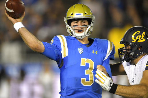 UCLA quarterback Josh Rosen, left, passes before being hit by California's Tony Mekari during the first half of an NCAA college football game, Friday, Nov. 24, 2017, in Los Angeles. (AP Photo/Mark J. Terrill)