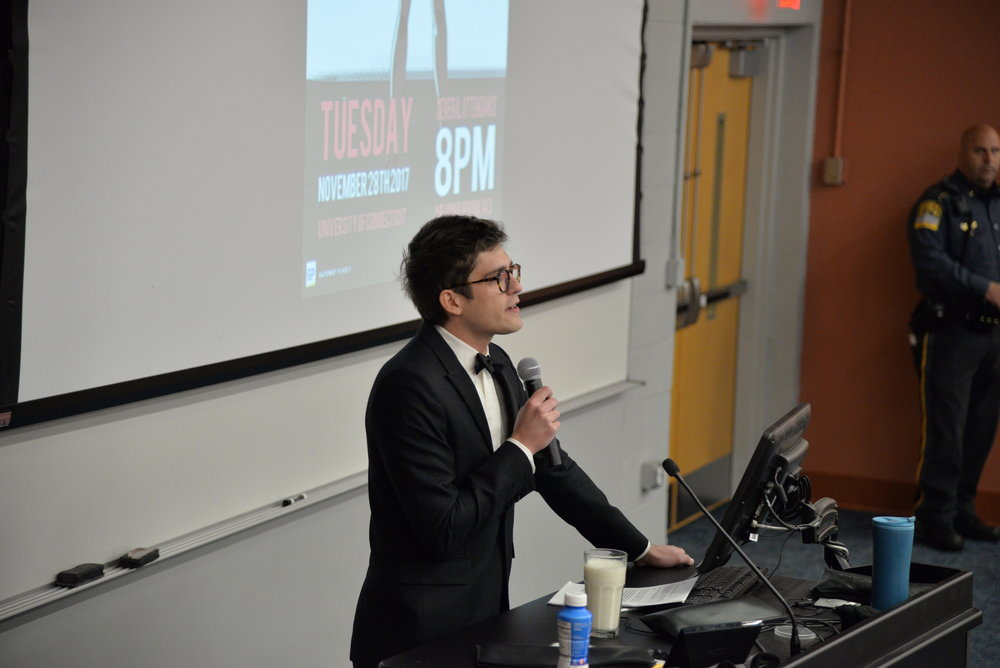 "Controversial conservative reporter Lucian Wintrich attempts to give a lecture titled ""It's Okay to Be White"" on Tuesday, Nov. 28, 2017. Wintrich was drowned out by protestors and was subsequently arrested after assaulting a protestor. (Amar Batra/The Daily Campus)"