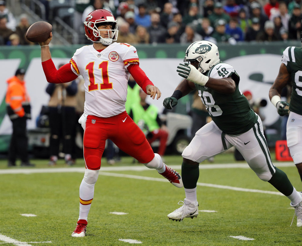 Kansas City Chiefs quarterback Alex Smith, left, throws during the first half of an NFL football game against the New York Jets, Sunday, Dec. 3, 2017, in East Rutherford, N.J. (Julie Jacobson/AP)